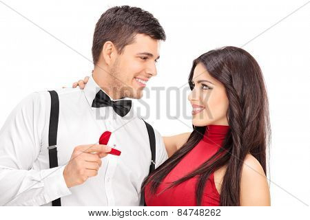 Man proposing to his girlfriend with diamond ring isolated on white background