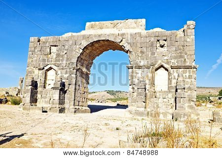 Old gate at Volubilis in Morocco. Volubilis is a partly excavated Roman city in Morocco situated near Meknes between Fes and Rabat.