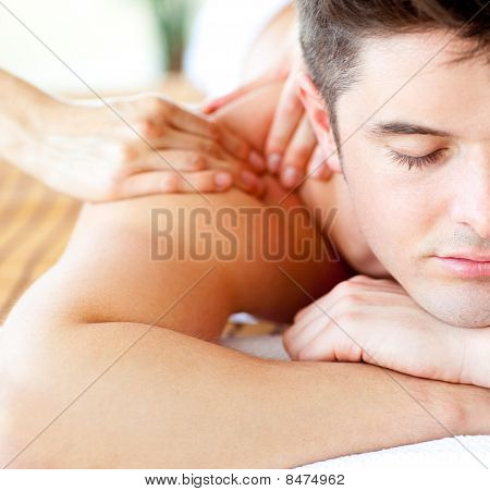 Close-up Of An Attractive Man Having A Back Massage