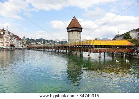 Lucerne Switzerland. Travel picture of landmark tourist attraction Kapellbrucke Chapel Bridge and Wasserturm water tower, Reuss River, Luzern.