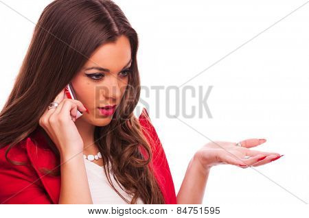 Young woman talking on the phone, studio shot