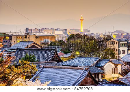 Kyoto, Japan city skyline over temple rooftops.