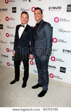 LOS ANGELES - FEB 22:  Cheyenne Jackson, Jason Landau at the Elton John Oscar Party 2015 at the City Of West Hollywood Park on February 22, 2015 in West Hollywood, CA