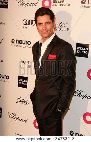 LOS ANGELES - FEB 22:  John Stamos at the Elton John Oscar Party 2015 at the City Of West Hollywood Park on February 22, 2015 in West Hollywood, CA