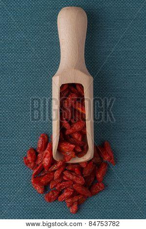 Wooden Scoop With Dry Red Goji Berries