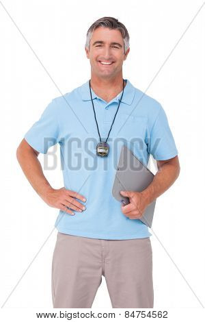 Trainer smiling at the camera on white background