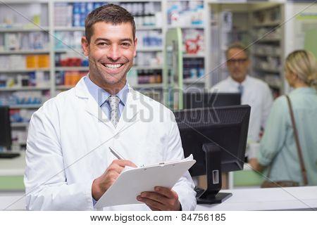 Happy pharmacist looking at camera at the hospital pharmacy