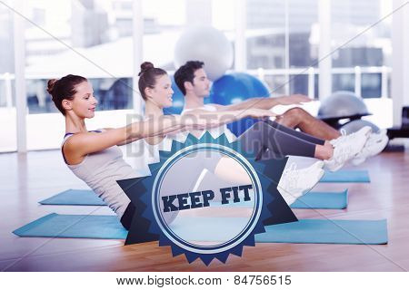 The word keep fit and class stretching on mats at yoga class against badge
