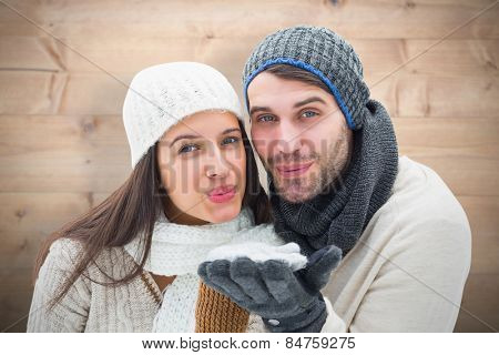 Young winter couple against bleached wooden planks background