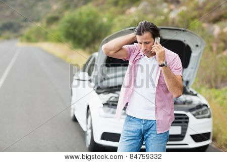 Man after a car breakdown at the side of the road