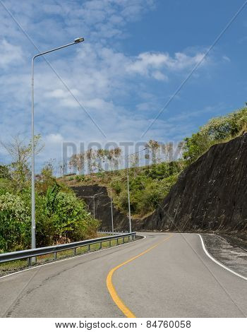 Asphalt Curve Road With Lighting Pole