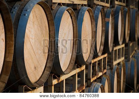 A stack of wine barrels at a vineyard