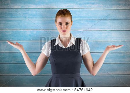 Businesswoman holding hands out in presentation against wooden planks