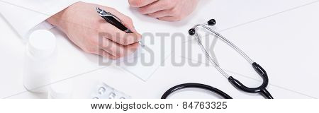 Doctor Writing Out A Prescription