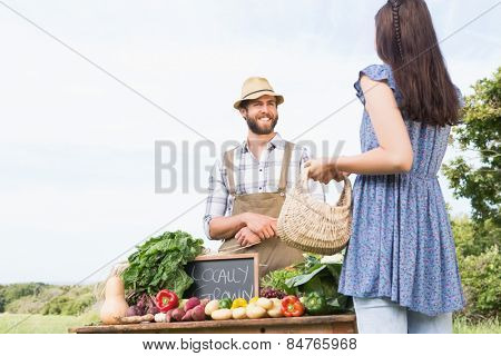 Farmer selling his organic produce on a sunny day
