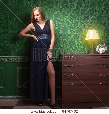 Woman In Blue Dress In Green Vintage Interior