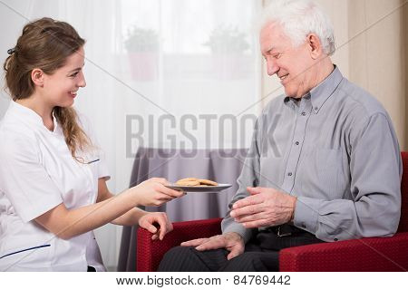 Care Assistant And Retired Man