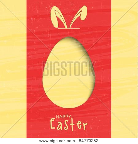 Creative greeting card design decorated with paper cut out egg and bunny ears for Happy Easter celebration.