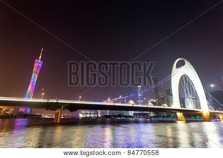 night scene of modern cityscape at riverside