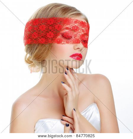 Mysterious beautiful blonde with ribbon on eyes