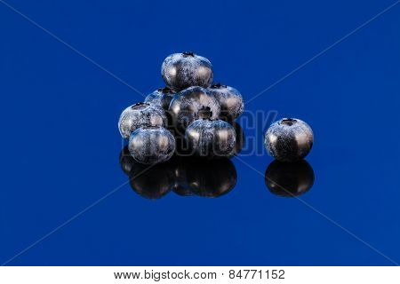 Blueberry On Blue Surface