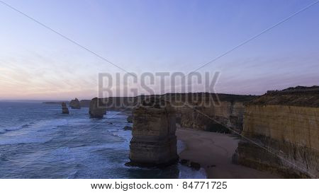 Sunset At Twelve Apostles Tourist Attraction On Green Ocean Road