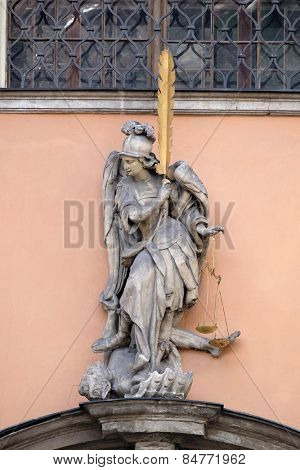 GRAZ, AUSTRIA - JANUARY 10, 2015: Archangel Michael on the portal of Dreifaltigkeitskirche ( Holy Trinity ) church in Graz, Styria, Austria on January 10, 2015.