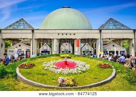 OSAKA, JAPAN - MAY 6, 2014: Tourists enter Tennoji Park. The park is a botanical gardens.