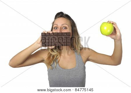 Attractive Woman Holding Apple And Chocolate Bar In Healthy Fruit Versus Sweet Junk Food Temptation