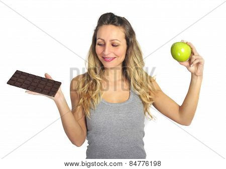 Attractive Woman Holding Apple And Chocolate Bar In Healthy Fruit Versus Sweet Junk Food Dilemma