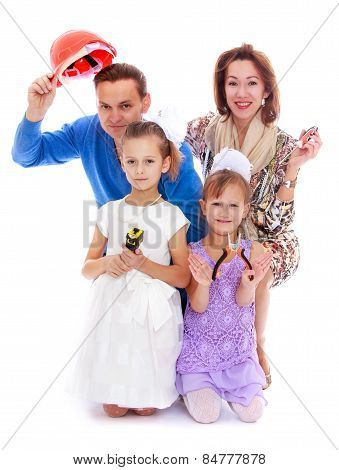 merry playful family mom dad and two daughters with construction