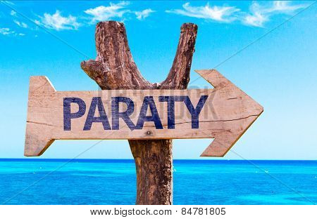Paraty wooden sign with a beach on background