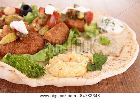 close up on pita bread sandwich