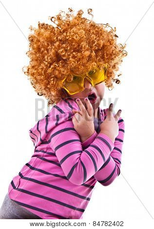 Musical kid with rock image sing with wig and star shaped glasses