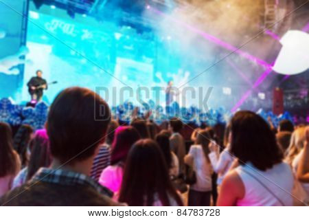 Blur background of people at the dj concert