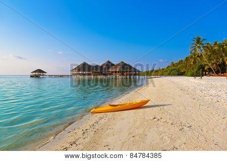 Boat on Maldives beach - nature vacation background
