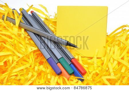 Markers with yellow sticky notes