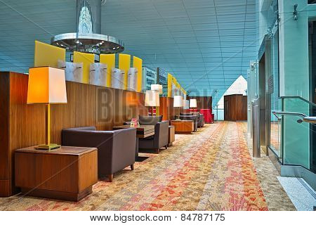 DUBAI, UAE - APRIL 18, 2014: business class lounge interior. Dubai International Airport is an international airport serving Dubai. It is a major airline hub in the Middle East