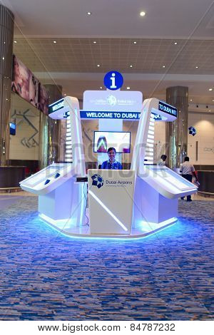 DUBAI, UAE - APRIL 18, 2014: airport help desk. Dubai International Airport is an international airport serving Dubai. It is a major airline hub in the Middle East, and is the main airport of Dubai.