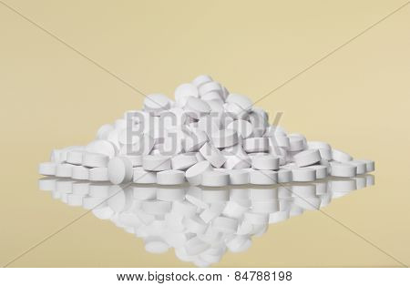 Stack of pills towards Yellow background