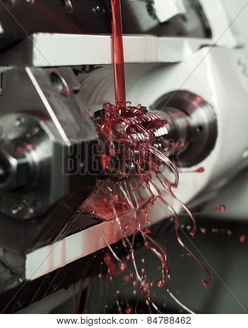 Close up of Red Floating Fluid in a machine