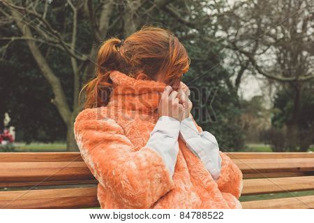 Young Woman Wrapping Up On Winters Day