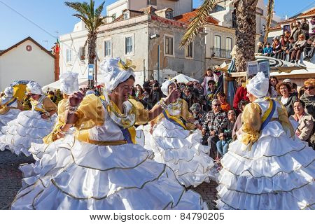 Sesimbra, Portugal. February 17, 2015: The Baianas, one of the most historically important characters of the Rio de Janeiro Brazilian style Carnaval Parade, dancing Samba. Represented by older women.