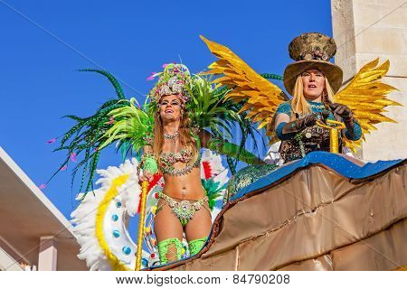 Sesimbra, Portugal. February 17, 2015: Liliana Filipa Antunes (left), a star from the Secret Story Reality Show, performing on top of a Float in the Rio de Janeiro Brazilian style Carnaval Parade.