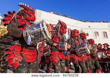Sesimbra, Portugal. February 17, 2015: Bateria, the musical section of the Samba School, playing for dancers in the Rio de Janeiro style Carnaval parade. Costumes of Predator, from the movie.