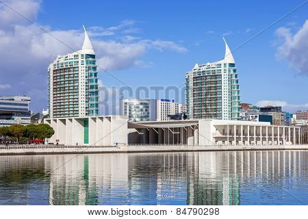 Lisbon, Portugal - February 01, 2015: Portuguese Pavilion (Pavilhao de Portugal), and Sao Gabriel (L) and Sao Rafael (R) Towers in the Park of Nations seen across the Olivais Dock in Lisbon, Portugal