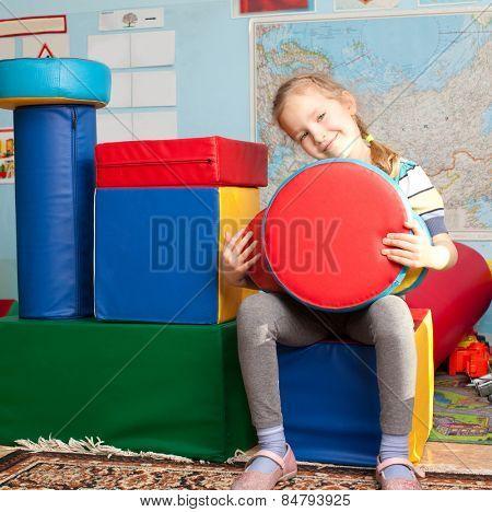 Children in kindergarten. Kids in nursery school. Girl playing box of bricks at infant school