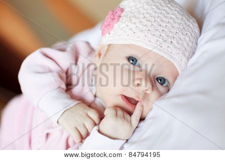 Baby at home. Newborn lying