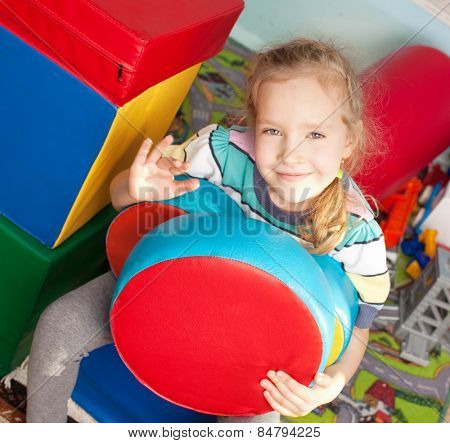 Children in kindergarten. Kids in nursery school. Girl playing box of bricks at infant school