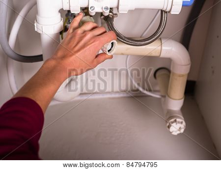 Female Hand Fixing Plumbing